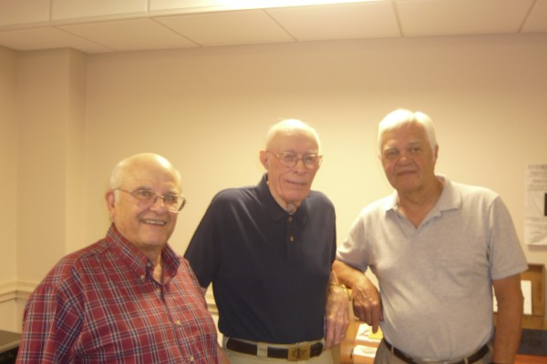 "Maine sea captain Dick Spear (center) with filmmaker-historians Gil Merriam (left) and Wayne Gray (right), during the premier of their historical film `""The Adventures of Captain Dick Spear"" at the Rockland Public Library this month. The film focuses on Spear's recollections of his first voyage across the Atlantic Ocean in 1939 on the 142-foot-long barkentine ""Capitana"" as a Rockland High School senior. The voyage instilled a love of the sea in Spear, who went on to graduate from Maine Maritime Academy, serve in the Merchant Marine during World War II and manage the Maine State Ferry Service for more than three decades."