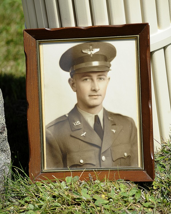 A photograph  of 2nd Lt. Robert Emerson of Norway sits by the grave site during his funeral at the Pine Grove Cemetery in South Paris on Saturday. Emerson was killed in 1945 when his B-25 Mitchell bomber crashed in the Philippines.