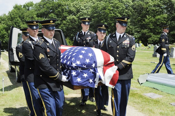Members of the Maine State Honor Guard carry the casket bearing the remains of 2nd Lt. Robert Emerson of Norway at the Pine Grove Cemetery in South Paris on Saturday. Emerson was killed in 1945 when his B-25 Mitchell bomber crashed in the Philippines.