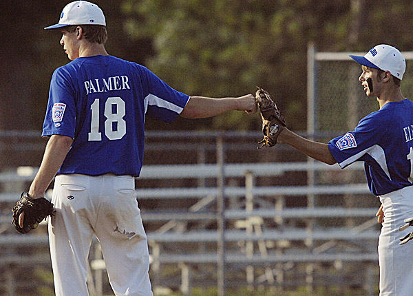 Waldo County pitcher Matt Palmer (left) gets some encouragement from teammate Buddy Ellis in the first inning of the state Senior League final Monday. Palmer went on to strike out 10 batters in the 7-2 victory.
