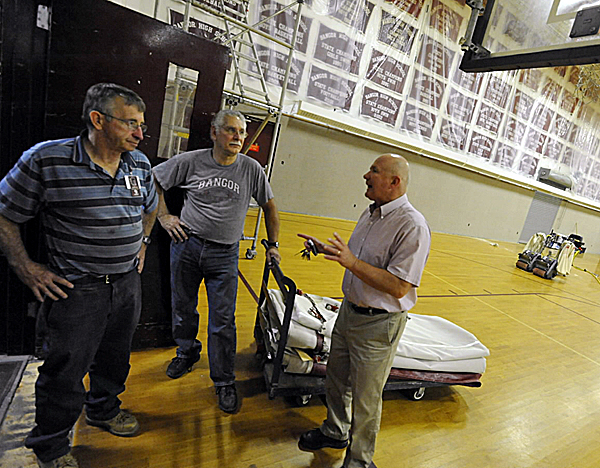 Bangor High School athletic director Steve Vanidestine, right discusses carpet wall and gym divider curtain upgrades with school maintenance staff Bob Matthews, left and John Knowlton, center, Tuesday at Bangor High School's Red Barry Gym. The upgrades are part of the school's Barry Gym renovation  which is slated for late September completion.