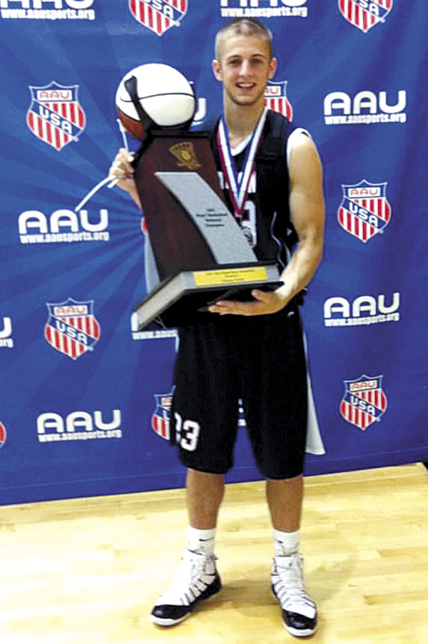 Chris Braley of Newport holds the championship trophy after he and his teammates from MBNation won the 18U AAU basketball national championship in Division 1. The Maine squad won the title Monday in Florida.