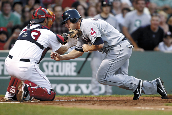 Cleveland Indians' Matt LaPorta is tagged out at home by Boston Red Sox catcher Jason Varitek during the second inning of a baseball game at Fenway Park in Boston on Thursday, Aug. 4, 2011.