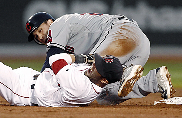 Boston Red Sox's Dustin Pedroia yells after being taken out by a sliding Cleveland Indians' Jason Kipnis after Kipnis was forced out at second on a ball hit by Asdrubal Cabrera during the second inning of a baseball game at Fenway Park in Boston on Thursday, Aug. 4, 2011. Cabrera was safe at first.