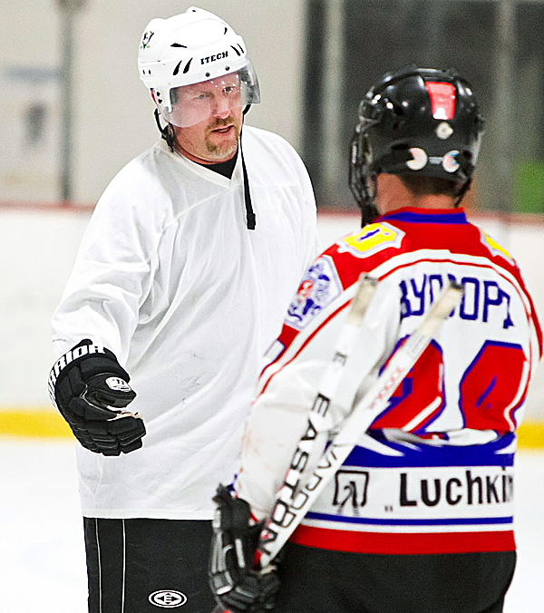 Matt Stairs talks to another player during a pickup hockey game at the Penobscot Ice Arena in Brewer Thursday night. Stairs enjoys the companionship and camaraderie of the hockey games.