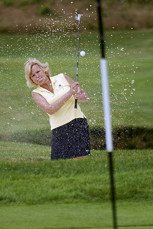 Nancy Pratt drops the ball on the green after hitting out of a sand trap on the eighth hole during the WMSGA State Championship Monday at Penobscot Valley Country Club in Orono. Pratt is the president of the WMSGA.