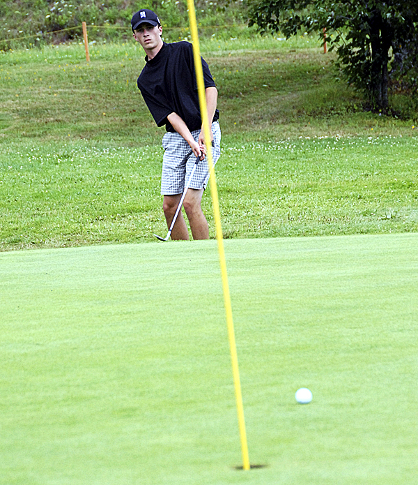 Sixteen-year-old Wyatt Foster of Howland misses a chip shot at Barnes Brook Golf Course in Enfield Monday. He is one of 52 golfers ages 5-17 who play in the Maine Junior Golf Club at the course.