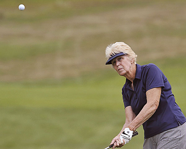 Pennie Cummings watches her chip shot onto the 9th green during day two of the WMSGA Championship at the Penobscot Valley Country Club in Orono, Maine, Tuesday August 9, 2011.
