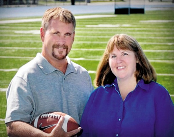 "Mike Hodgson and Sandy Caron have written, ""Tackling Football: A Woman's Guide to Understanding the College Game."""