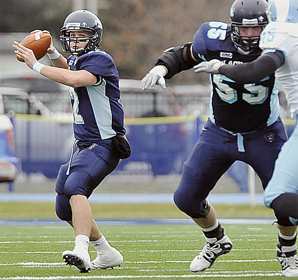 Maine quarterback Chris Treister looks for a receiver while Matt Barber provides pass protection during a game against Rhode Island in 2009. Treister is battling for the starting job with Warren Smith.
