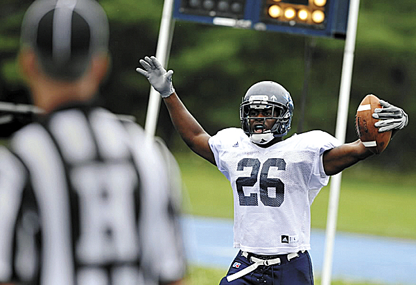University of Maine freshman running back David Hood of Galloway, N.J.,  reacts after catching a toucdown pass during the Black Bear's intrasquad scrimmage on Morse Field Monday afternoon.