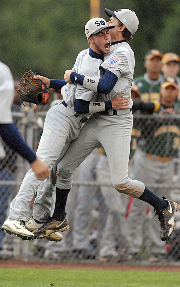 Asher Boudreaux (left) and Sawyer Dorsey from Tyler, Texas, celebrate their 8-6 victory over Talbot County, Md., in their Senior League World Series game on Tuesday. Texas won 8-6.