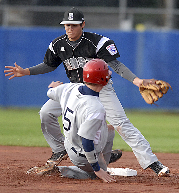 William Finley of Tyler, Texas, steals second as Brian Delaney of Talbot County, Md., misses the ball in the seventh inning.  Tyler, Texas, won 8-6 over Talbot County, Md., in their Senior League World Series game on Tuesday.