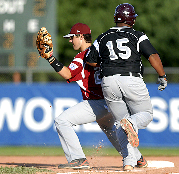 Brewer first baseman John Hand makes the out against U.S East's Tayvon Blake in the forth inning of the Senior Little League World Series game Wednesday at Mansfield Stadium in Bangor.