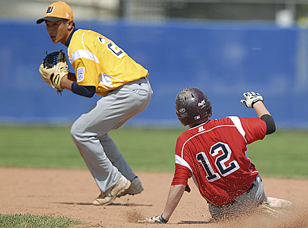 Kolten Yamaguchi from Hilo, Hawaii, denies Jonathan Hentschel of Midland, Mich., second base in the bottom of the seventh inning during their Senior Little League World Series game Thursday. Hawaii won 7-1 and will advance to Friday's semifinals as the Pool B winner.