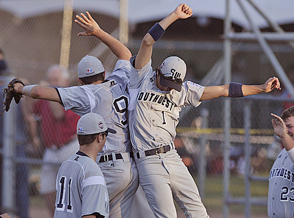Tyler, Texas, players Marty Antilley (1) and Seth Gibson (9) celebrate after getting the third Brewer-Orrington out in the fourth inning of Thursday's Senior League World Series game at Mansfield Stadium in Bangor. Texas, the U.S. Southwest champs, won 10-0 in five innings.