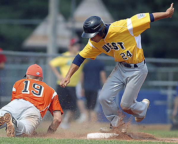 Kolten Yamaguchi of the U.S. West team steals third base and heads toward home as Europe-Middle East-Africa's Alessandro Tonzar fails to come up with the throw from the catcher during Friday's Senior League World Series semifinal at Mansfield Stadium in Bangor. Hilo, Hawaii, advanced to the championship game with a 10-0 victory.