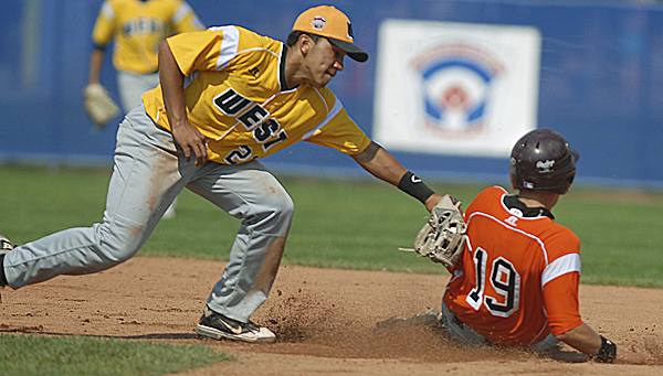 U.S. West shortstop Kean Wong of Hilo, Hawaii, tags out EMEA's Alessandro Tonzar at second base in the fourth inning of the Friday afternoon semifinal game. U.S. West defeated Italy 10-0 in five innings.  They will advance on to the Senior Little League World Series championship game on Saturday where they will compete against the U.S. Southwest team from Tyler, Texas, at 2 p.m.