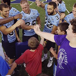 Local Maine children got a chance to share the field with University of Maine football players Wednesday night at Morse Field in Orono. Kids were able to run drills, tackle and catch the football with players.