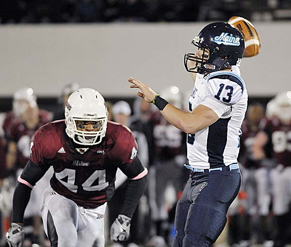 Massachusetts' Perry McIntyre pressures Maine quarterback Warren Smith during a game last season. Smith was named Maine's starting quarterback Thursday night by coach Jack Cosgrove.