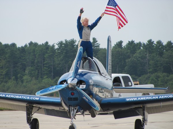 Capt. Julie Clark, one of the stunt pilots who performed Saturday, August 27, 2011 at the Great State of Maine Air Show and Business Aviation Expo, stands on the cockpit of her Chevron Mentor T-34 aircraft as it rolls to a stop in front of thousands of spectators.