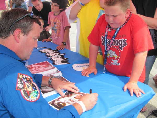 NASA astronaut Mike Foreman gives an autograph to 10-year-old Jackson Harbaugh of Portland at the Great State of Maine Air Show and Business Aviation Expo on Saturday, August 27, 2011 in Brunswick. Harbaugh said meeting an astronaut for the first time was a thrill.