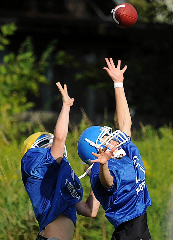 Belfast High School's Owen Falvey (right) and Carl Dodge go up for a pass during practice last week.