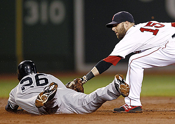 Eduardo Nunez of New York slides under the tag of Boston second baseman Dustin Predroia to leg out a double during the third inning of Wednesday night's game at Fenway Park in Boston. The Red Sox beat the Yankees 9-5.