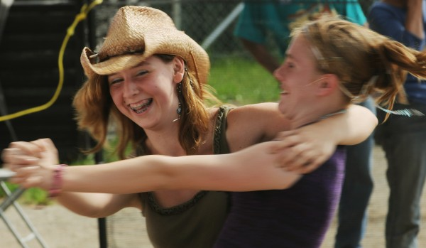 "&quotMusic is my life,&quot said Shannon Hardy (right) as she and friend Kyra Metcalf kick up the dust in front of the Railroad Stage to the sounds of Hot Club of Cowtown on Saturday, Aug. 27, 2011 at the American Folk Festival in Bangor. ""This [folk festival] tops all of them I've been to,"" Metcalf added as the band was leaving the stage."
