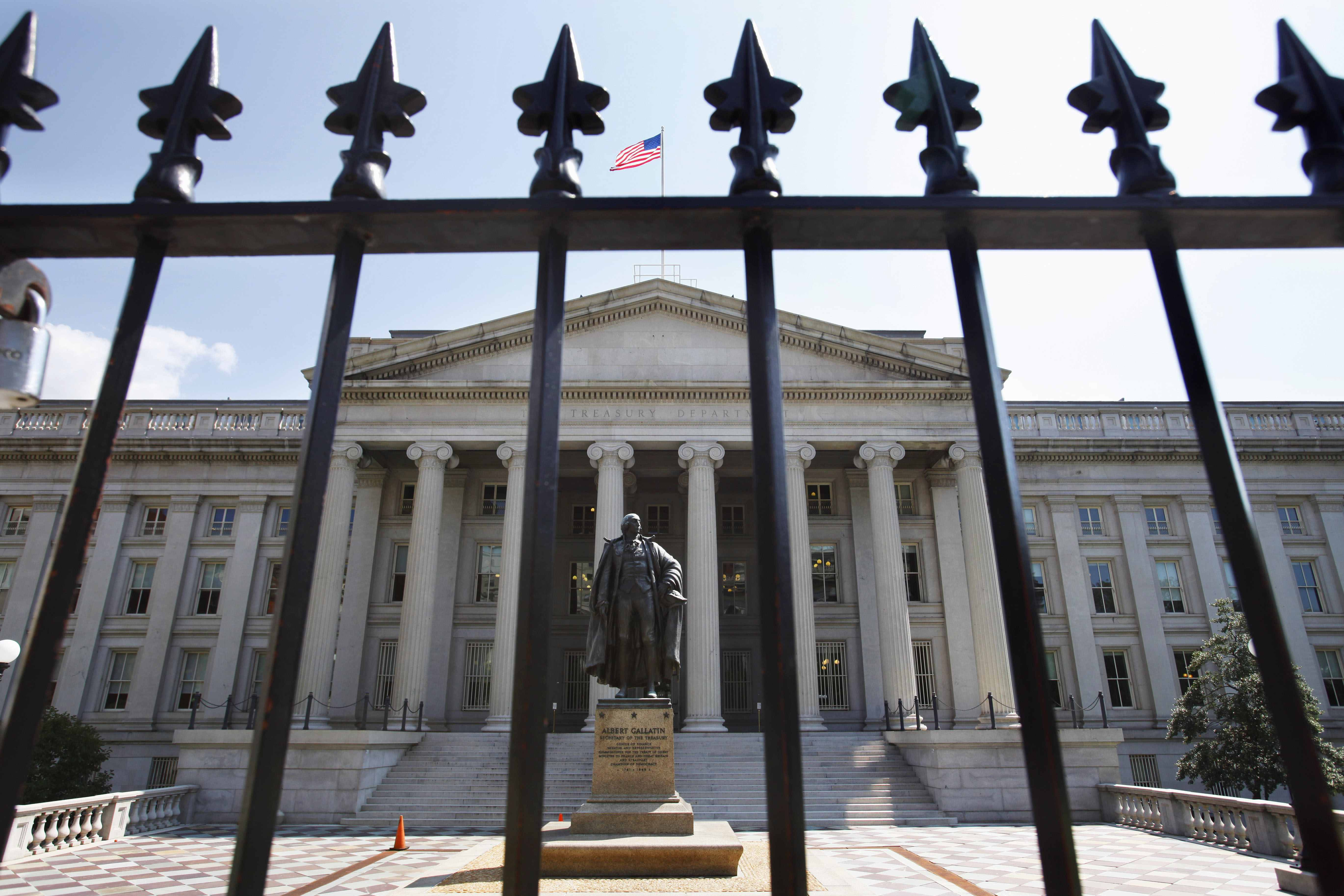 A statue of former Treasury Secretary Albert Gallatin stands guard outside the Treasury Building in Washington, Monday, Aug. 8, 2011, as stocks slid Monday amid a rout in global stocks after Standard & Poor''s downgraded the U.S. credit rating.