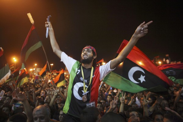 People celebrate the capture in Tripoli of Moammar Gadhafi's son and one-time heir apparent, Seif al-Islam, at the rebel-held town of Benghazi, Libya, early Monday, Aug. 22, 2011.