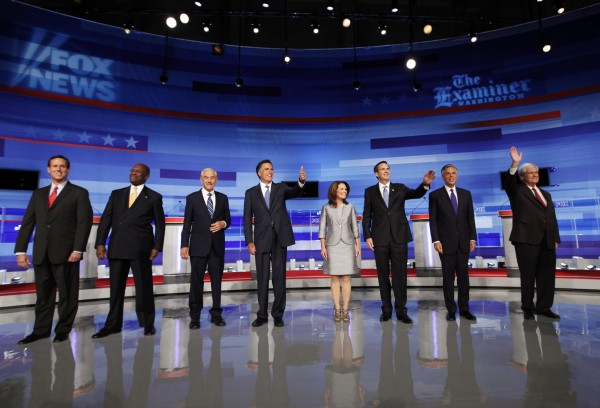 Republican presidential candidates pose for a photo before the start of the Iowa GOP/Fox News Debate at the CY Stephens Auditorium in Ames, Iowa, Thursday, Aug. 11, 2011. Pictured from left to right: former Pennsylvania Sen. Rick Santorum; businessman Herman Cain; Rep. Ron Paul, R-Texas, former Massachusetts Gov. Mitt Romney; Rep. Michele Bachmann, R-Minn.; former Minnesota Governor Tim Pawlenty; former Utah Gov. Jon Huntsman; former House Speaker Newt Gingrich.