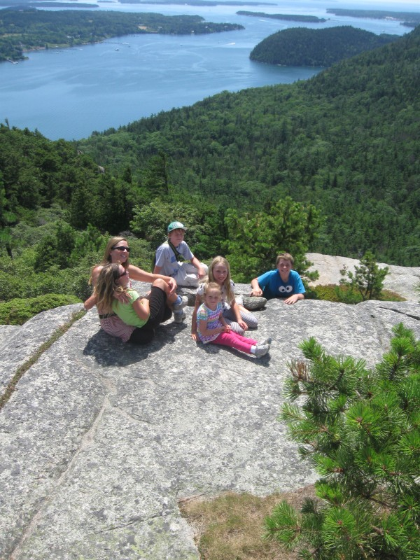 The kids and my sister-in-law sitting atop Acadia Mountain.