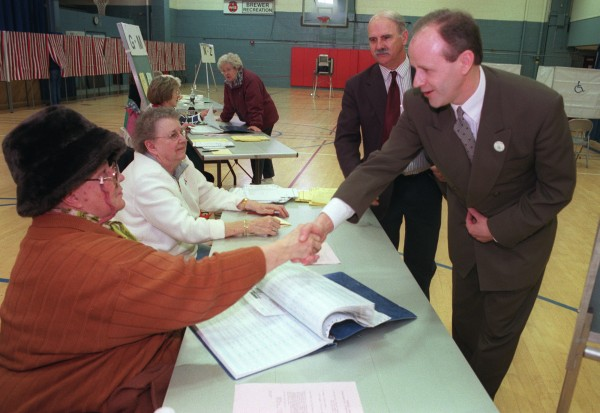 Dan Gwadosky, Maine's secretary of state at the time, thanks Brewer ballot clerks in 2000.
