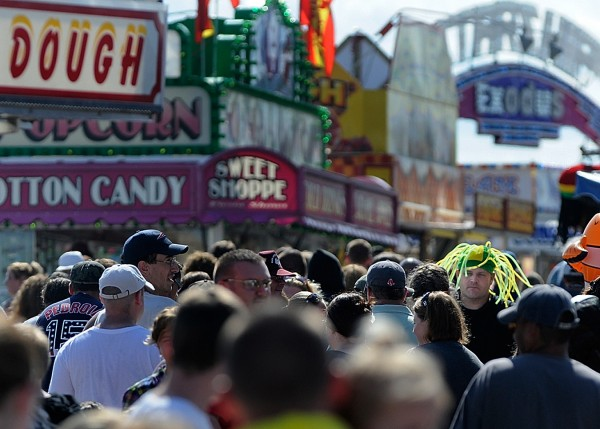 Thousands make their rounds through the Bangor State Fairground Saturday afternoon, July 30, 2011.