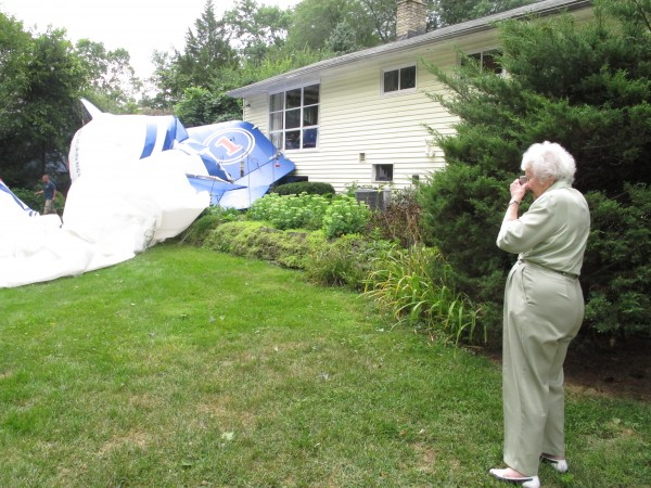 Lillian Bernhagen takes photos of a blimp that broke free of its moorings at an airport and landed in her backyard on Sunday, Aug. 14, 2011, in Worthington, Ohio.