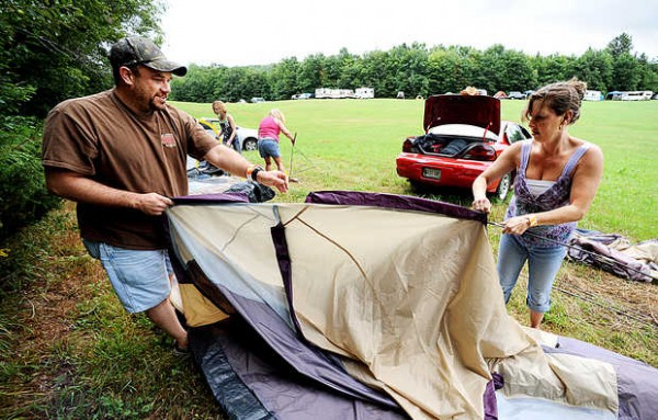 &quotWe wanted to get here early because we thought it would get busy later,&quot said Jen King (right) of Auburn as she set up a tent with Ray Dumais of Lewiston at the inaugural Redneck Olympics on Friday morning in Hebron. The event kicks off at 9:30 a.m. Saturday with opening ceremonies and a host of competitions such as bobbing for pigs' feet, a wife-carrying contest and lawn mower races.
