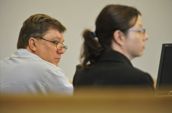 Seated next to defense attorney Karen Wolfram, Jeffrey Cookson (left) of Dexter looks towards Assistant Attorney General Lisa Marchese (not pictured) during a hearing at the Penobscot Judicial Center on Wednesday, Aug. 31, 2011. Cookson, 47, is serving consecutive life sentences at the Maine State Prison for the December 1999 slayings of his ex-girlfriend Mindy Gould, 20, and the boy she was baby-sitting, Treven Cunningham, 21 months old, both of Dexter.