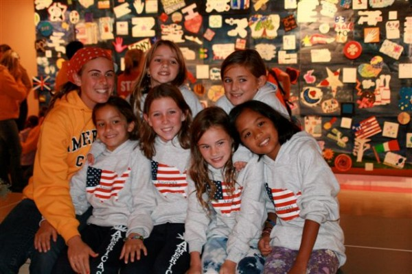 Happy youngsters who attended last year's &quotAmerica's Camp&quot pose for the camera wearing their American Flag T-shirts.