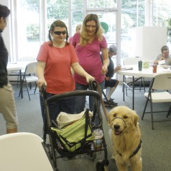 Carlene Rice of Brewer and her sister direct support personnel Danielle Littlefield make their way, with Carlene's service dog, Gibbs, into Citizens of Maine.