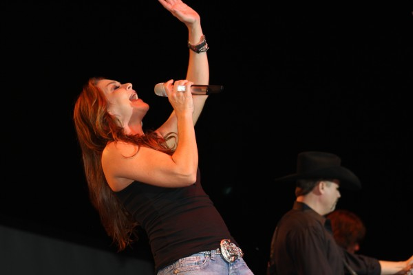 "Gretchen Wilson leans back to hit a high note as she sings ""Here for the Party"" during Feed the County Summerfest on Aug. 20."