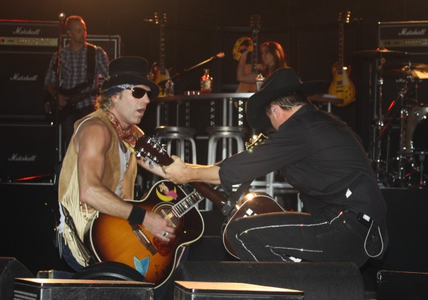 Big & Rich strums it out down low during the Aroostook County portion of the their Xtreme Muzik tour with Gretchen Wilson (background, right).
