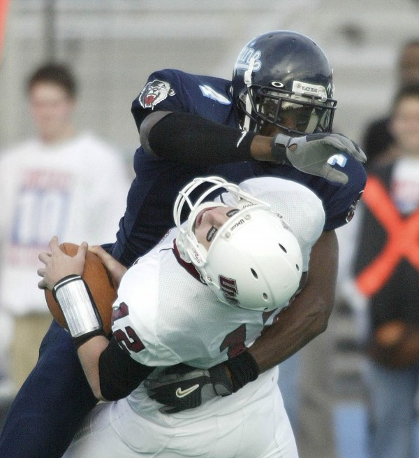 Daren Stone of the University of Maine sacks Massachusetts quarterback Liam Coen in 2005.
