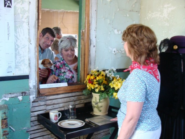 Patty Ferland (right) of The Friends of the Greenville Junction Depot explained to Steve and Kathy Ryder of Shirley on Saturday how the ticket