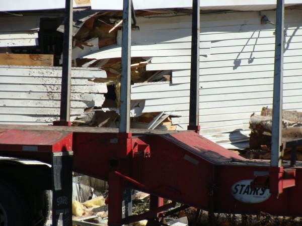 The Cambridge General Store was damaged early Tuesday, Aug. 23, 2011, when the driver of a tractor-trailer loaded with pulp wood lost conrol and the vehicle tipped over and slid into the side of the store where the coolers are located.