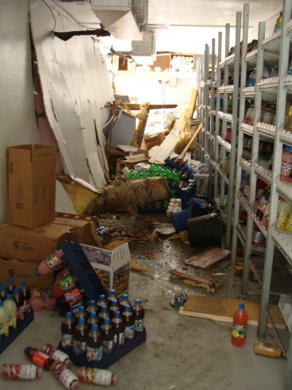 The cab of a tractor-trailer crashed into the Cambridge General Store early Tuesday, Aug. 23, 2011, doing several thousands dollars worth of damage.