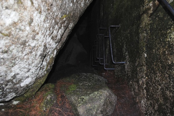 The rungs lead to the bottom of the Debsconeag Ice Caves, where snow and ice can be found all year.