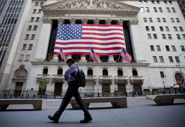 In this Aug. 5, 2011, file photo a pedestrian walks past the New York Stock Exchange on earl in New York, a day stocks around the world tumbled ahead of crucial U.S. jobs figures. Anger at the nation's leaders for taking so long to strike a debt-ceiling deal has turned into high anxiety over jobs and the economy amid growing fears of a new recession. Standard & Poor's downgrading of the nation's credit rating a notch for the first time ever only added to the tension.