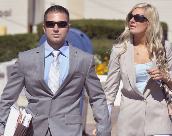 Derek Stansberry (left) and his girlfriend, Jillian Krause, leave the U.S. Federal Court in Bangor on Tuesday, Aug. 23, 2011. Stansberry has been found not guilty by reason of insanity on charges stemming from his claim to have been carrying dynamite on a Paris to Atlanta flight that was diverted to Bangor on April 27, 2010.