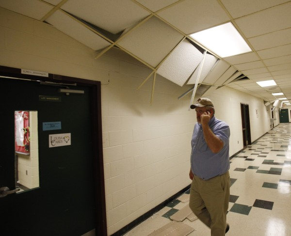 School board member Brian Huffman walks the halls surveying the damage to Louis County High school after a 5.8 magnitude earthquake in Mineral, Virginia on Tuesday, Aug. 23, 2011.